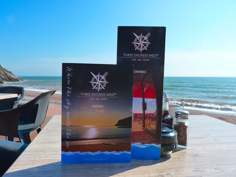 3DW menus on a beachside table in the sun